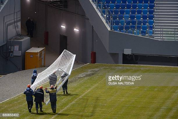 Workers carry a goal inside Krestovsky football stadium, also known as Zenit Arena and currently under construction for the 2018 FIFA World Cup, in...
