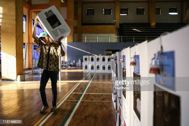 Workers carry ballot boxes for distribution to the polling stations in a warehouse in Jakarta Indonesia on 16 April 2019 Some 192 million Indonesians...