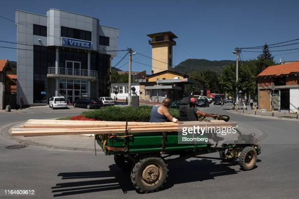 Workers carry planks of wood on a truck in Vranje Serbia on Wednesday Aug 21 2019 Serbias estimated lithium deposits are the largest in Europe and...