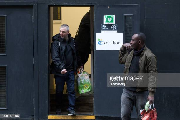 Workers carry plastic bags from the site office of the Arundel Great Court development operated by Carillion Plc in London UK on Monday Jan 15 2018...
