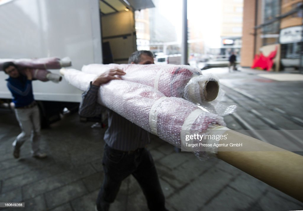 Workers carry the main red carpet to the Berlinale Palast for the 63rd Berlinale International Film Festival on February 4, 2013 in Berlin, Germany. The 2013 Berlinale will run from February 7-17, 2013