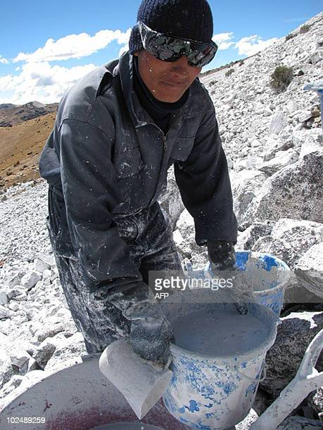 Workers carry whitewash mortar to peaks over 4,700 meters of altitude in the Peruvian Andes on May 21 as part of an experimental plan to recuperate...