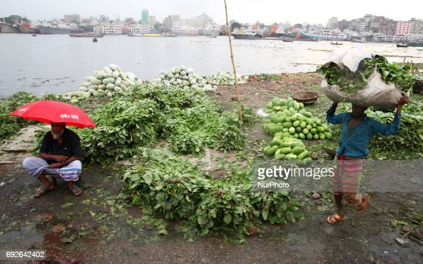 A workers carrying goods near the riverbank of Buriganga on the eve of World Environment Day in Dhaka Bangladesh 05 June 2017 A large swathe of the...