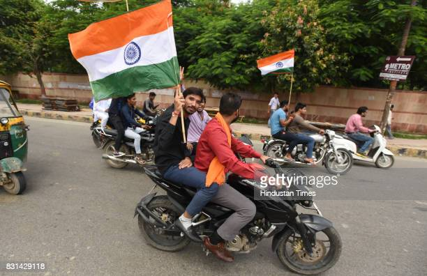 BJP workers carrying Indian National flag during the Tiranga Yatra on August 14 2017 in Noida India