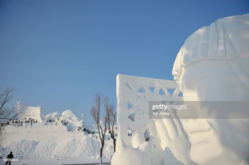 Workers carve the main sculpture 'Snow song Winter Olympics' for the 30th Harbin Sun Island international Snow Sculpture Art Exposition on December 7, 2017 in Harbin, China.The 30th Harbin Sun Island International Snow Sculpture Art Exposition runs from 20 December 2017 to 28 February 2018.