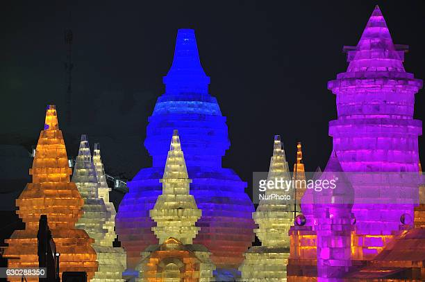 Workers carving ice sculpture at Ice and Snow World park in Harbin city of China on December 20 2016 Ice and Snow World park will trial opening in...