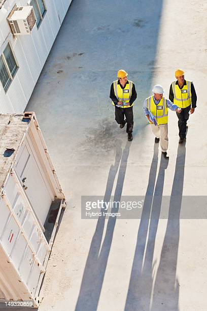 workers casting shadows on site - safety stock pictures, royalty-free photos & images