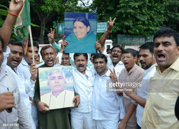 RJD workers celebrate after victory in Bihar assembly bypolls on August 25 2014 in Patna India RJDJDUCongress alliance won six while BJP won 4 seats...