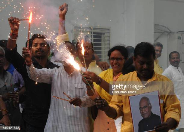 BJP workers celebrate at party office after NDA candidate Ram Nath Kovind was elected as 14th President of India on July 20 2017 in Lucknow India NDA...