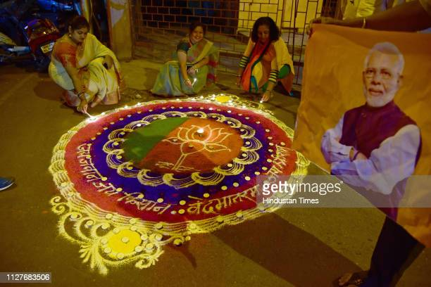 Workers celebrate Indian Air Force attack on JaisheMohammed by drawing rangoli and liting up candles at BJP Office Vashi on February 26 2019 in Navi...