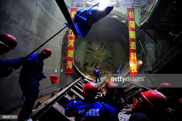 Workers celebrate the compeletion of the first tunnel across the Yellow River on December 22, 2009 in Zhengzhou, China. The tunnel's completion marks...