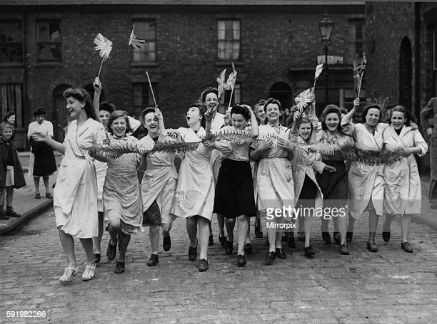 Workers celebrate Victory in Europe Day in Manchester at the end of the Second World War. 8th May 1945.