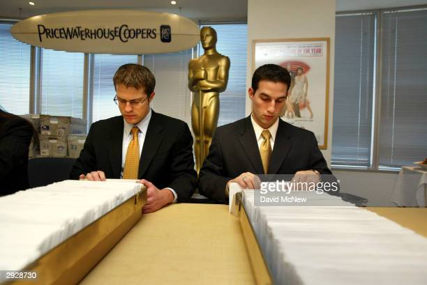 Workers ceremoniously pretend to sort the final 76th Academy Awards ballots during the traditional photo op before they are mailed on February 4,...