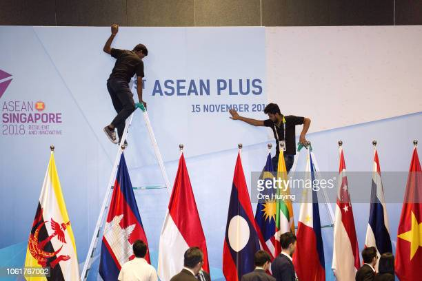 Workers change the backdrop during the 33rd Association of Southeast Asian Nations Summit and Related Meetings on November 15 2018 in Singapore...
