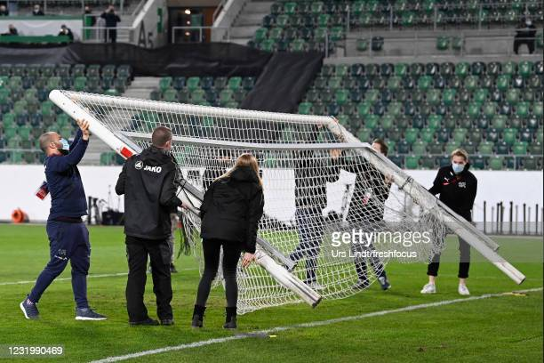 Workers change the goal during the FIFA World Cup 2022 Qatar qualifying match between Switzerland and Lithuania at Kybunpark on March 28, 2021 in St...