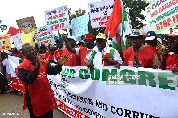 Workers chant slogans in support of anti corruption drive of the government during a rally in Abuja on September 10 2015 Workers under the platform...