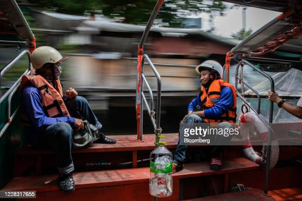 Workers chat while travelling by water taxi in Bangkok Thailand on Wednesday Sept 2 2020 Thailand has reported zero locallytransmitted Covid19 cases...