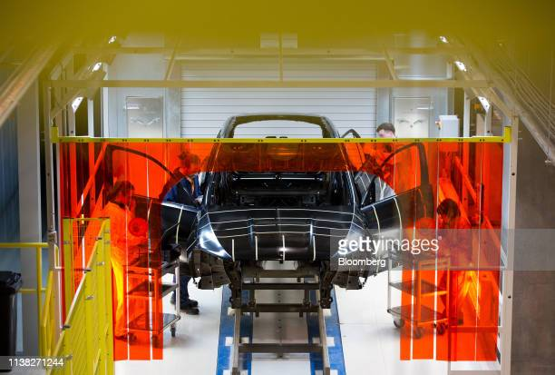 Workers check a MercedesBenz GLCclass automobile on the production line at the Daimler AG luxury automobile plant in Moscow Russia on Friday April 19...