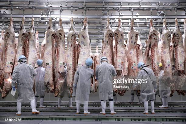 Workers check Kobe beef certified by the Kobe Beef Marketing and Distribution Promotion Association in a refrigerated storage room prior to an...