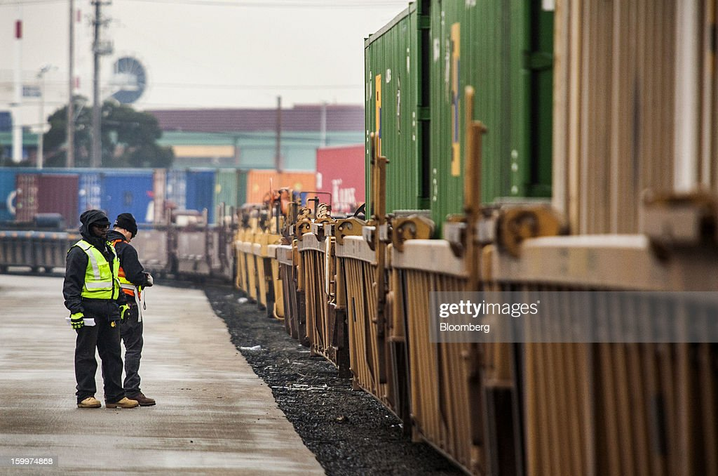 Workers check railcars that are coupled together at the Union Pacific Intermodal Terminal in Oakland, California U.S., on Wednesday, Jan. 23, 2013. Union Pacific Corp., the largest U.S. railroad by sales, posted higher fourth-quarter earnings than analysts estimated as shipments of chemicals and automobiles climbed. Photographer: Ken James/Bloomberg via Getty Images