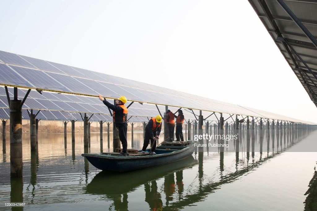 Photovoltaic Power Station Fishing : News Photo
