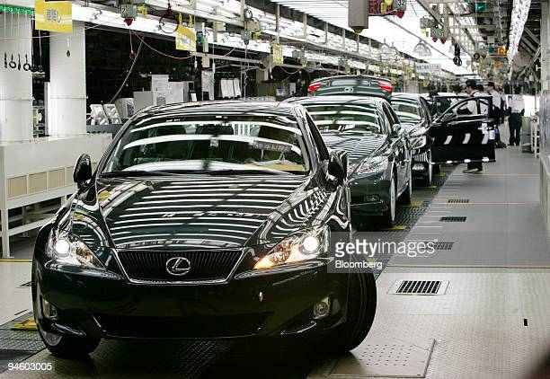 Workers check Toyota Motor Corp's luxury series Lexus LS600 hybrid sedans on the production line at its Tahara plant in Tahara central Japan Thursday...