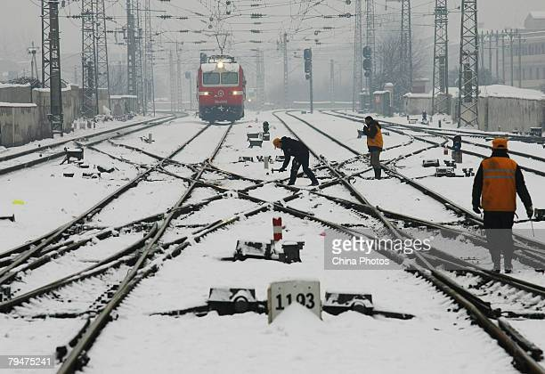 Workers check tracks at the Hankou Railway Station after heavy snow on February 1 2008 in Wuhan of Hubei Province China The worst prolonged snow rain...
