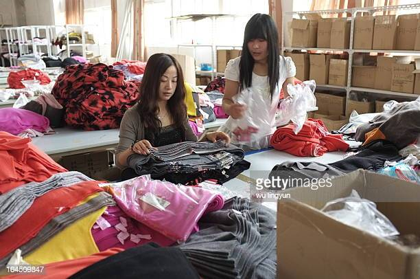 Workers checking sweaters' quality in China's sweater factory.