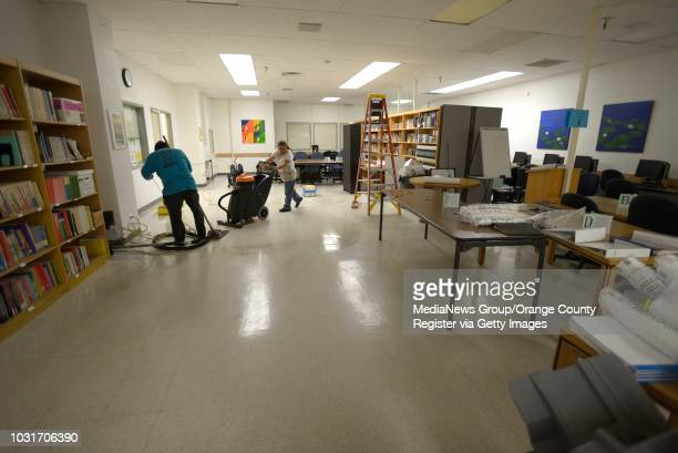 Workers clean a floor that was flooded in the basement of the Student Union at Long Beach City College ///ADDITIONAL INFORMATION Slug...