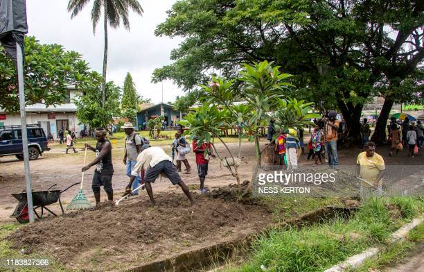 Workers clean a street ahead of an historical independence vote in the capital Buka on November 22 2019 The resourcerich Pacific archipelago of...