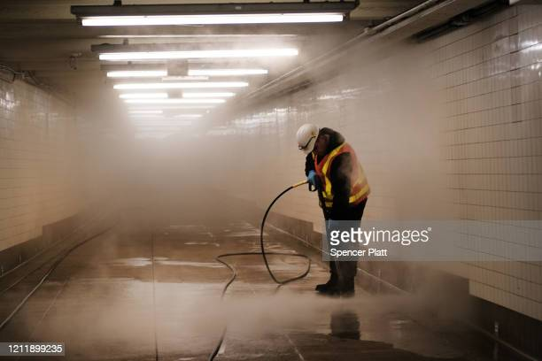 Workers clean a subway station in Brooklyn as New York City confronts the coronavirus outbreak on March 11 2020 in New York City President Donald...
