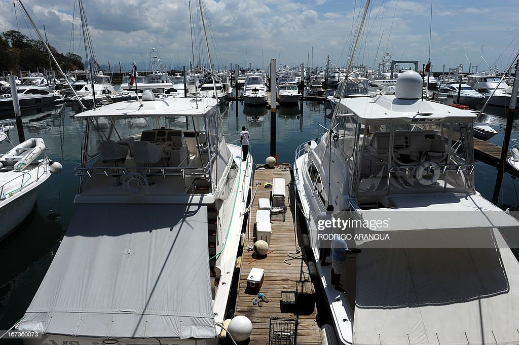 Workers clean a yacht at Puerto Amador, in the suburbs of Panama City on April 24, 2013. AFP PHOTO/ Rodrigo ARANGUA