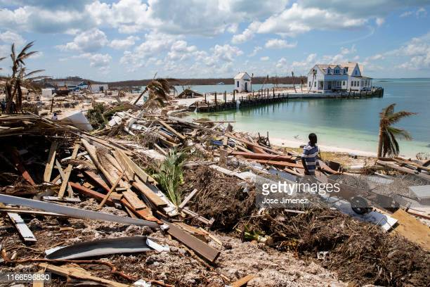 Workers clean debris at the Abaco Inn in Hurricane Dorian devastated Elbow Key Island on September 7, 2019 in Elbow Key Island, Bahamas. The official...