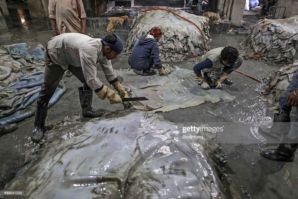 Workers clean hides at the Jalandhar Leather Pvt tannery in Jalandhar Punjab India on Friday Jan 20 2017 India`s 51 million micro small and medium...