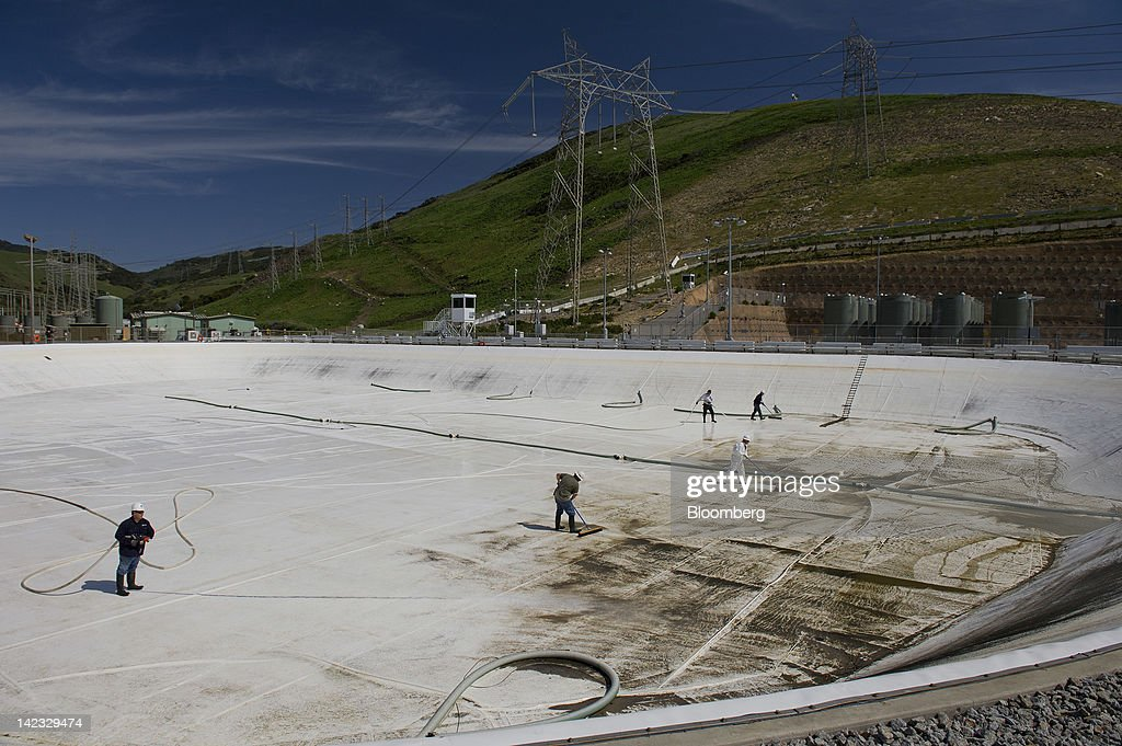 Workers clean out one of the two fresh water reservoirs at the Pacific Gas and Electric Co. (PG&E) Diablo Canyon nuclear power plant in Avila Beach, California, U.S., on Friday, March 30, 2012. U.S. nuclear-power production fell 2.1 percent to the lowest level in more than 10 months as four reactors shut in Pennsylvania, Florida, Alabama and Texas. Photographer: David Paul Morris/Bloomberg via Getty Images
