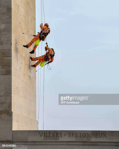 Workers clean the facade of the Australian National Memorial on September 26 2017 in VillersBretonneux northern France This memorial is the main...