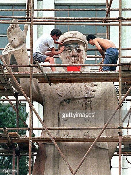 Workers clean the face of Mao Zedong's statue at a college in Beijing 23 August Thirty years ago China's urban residents were forced to the...