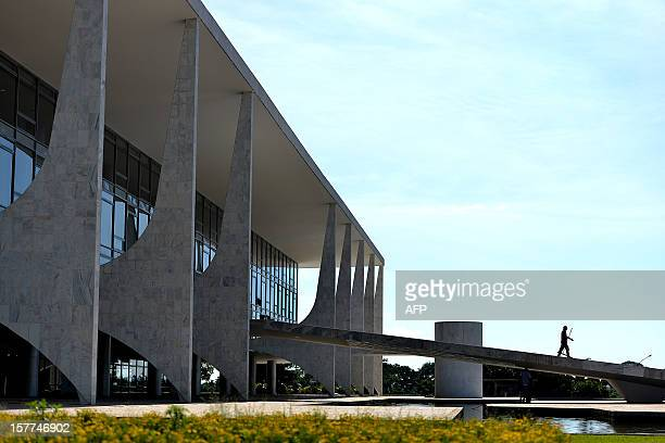 Workers clean the Planalto Palace ramp in Brasilia on December 6 awaiting for the arrival of the coffin with the remains of Brazilian renown...