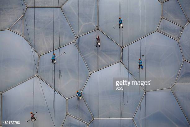 Workers clean the Water Cube on July 27 2015 in Beijing China