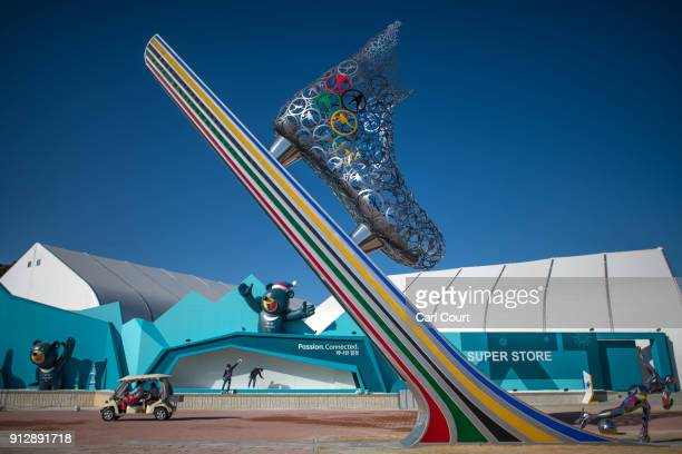Workers clean the windows of a building in the Gangneung Coastal Cluster one of the venues for the Pyeongchang 2018 Winter Olympic Games as they...