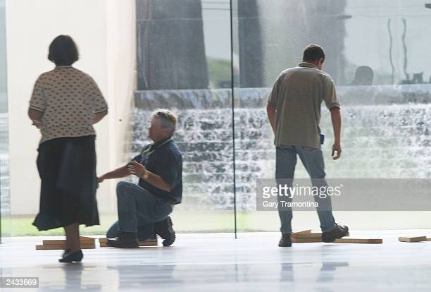 Workers clean up after the Ten Commandments monument was removed from the rotunda of the State Judicial building August 27 2003 in Montgomery Alabama...