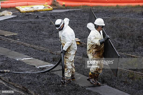 Workers clean up an oil spill at BP Plc's Prudhoe Bay oil fields in Alaska August 11 2006 BP Plc will keep pumping crude from the western half of...