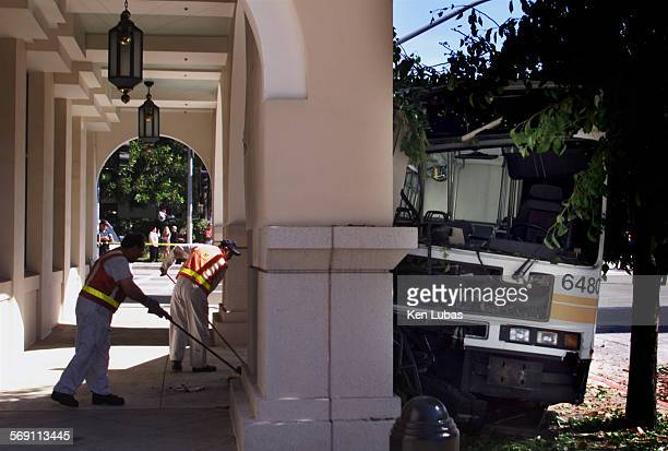 MTA workers clean up debris after bus was struck by a car and crashed into an arch at the Double Tree Hotel in Pasadena Monday morning June 18 2001...