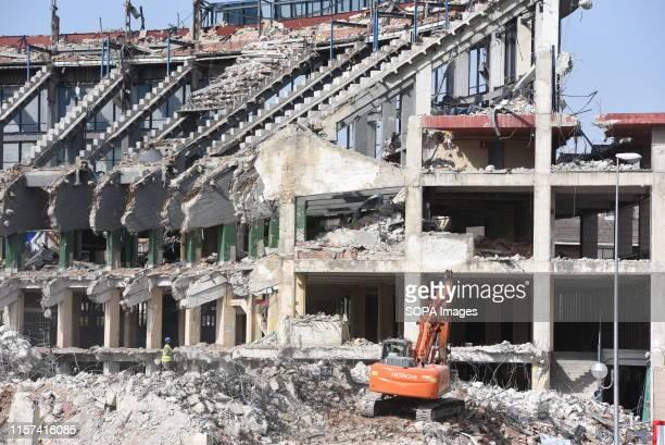 Workers clean up debris as demolition continues at the Vicente Calderon in Atletico de Madrid old stadium Vicente Calderon stadium was named after...