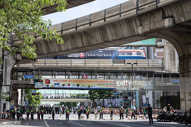 Workers clean up debris from the site of the explosion on August 18, 2015 in Bangkok, Thailand. Last night a bomb explosion in the centre of Bangkok,...