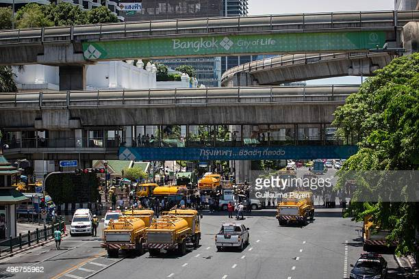 Workers clean up the debris from the explosion last night in Central Bangkok. The death toll as risen to more then 21 with 123 injured from the...