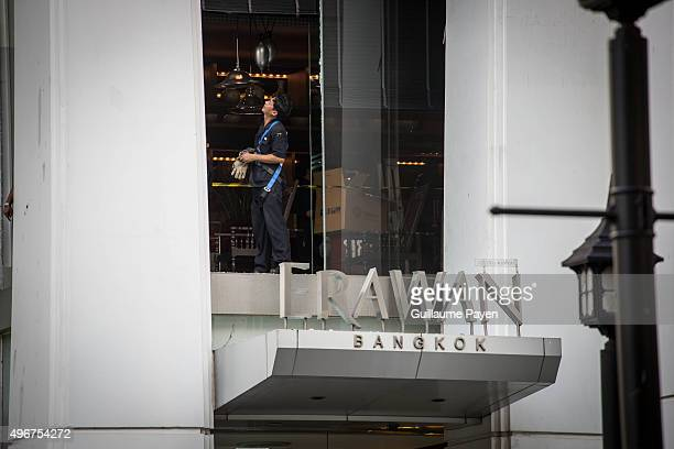 Workers clean up the Erawan Building as most of the windows are broken due to the bomb who exploded outside a religious shrine in central Bangkok,...