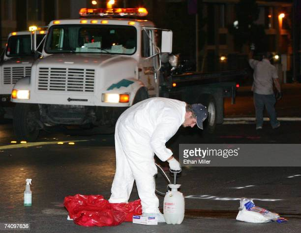 Workers clean up the road where boxer Diego Corrales crashed his motorcycle and died according to a report from boxing promoter Gary Shaw May 7 2007...