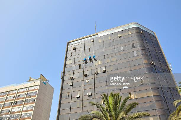 workers cleaning building in lima - markus daniel stock pictures, royalty-free photos & images