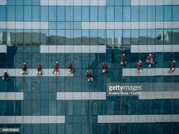 workers cleaning window of office building - window cleaning stock photos and pictures